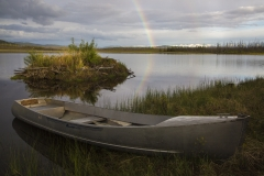 A rainbow breaks after a storm in the backcountry of Alaska.